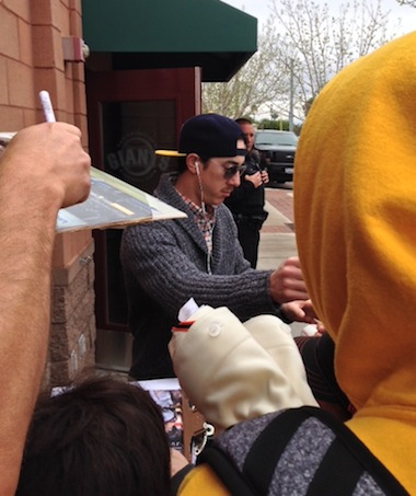 Tim Lincecum signs for the fans, surrounded by a respectful silence.
