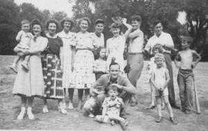 Family picnic, Dad in front with me (the blur) and my brother, mom in back with a glove on her head (?) and cousin Bob with a bat in his hand.